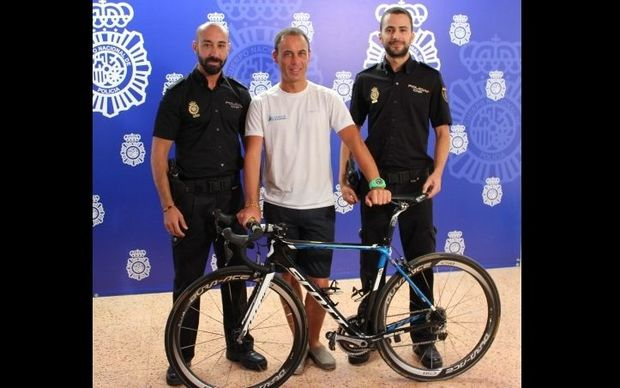 Local police with the specialist bike that was found in a second-hand store.