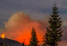 USA, Kings Canyon: The so-called Rough wildfire — which had spread over 95,000 acres in the Sierra Nevada mountains by September 8, 2015 — is photographed as it burns through Kings Canyon National Park in California on August 28