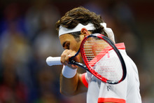 Roger Federer of Switzerland reacts against Novak Djokovic of Serbia during their final at the 2015 US Open at the USTA Billie Jean King National Tennis Center on September 13, 2015 Mike Stobe/Getty Images for the USTA/AFP