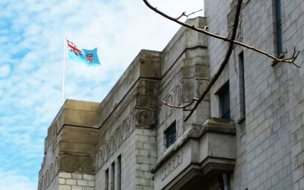 Fiji flag flies on the rooftop of parliament
