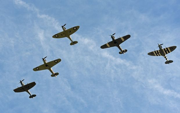 World War II planes fly over Buckingham Palace earlier this year.