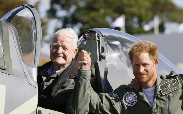 Britain's Prince Harry poses with World War II veteran Tom Neill after he flew in a Spitfire during a Battle of Britain display at Goodwood Aerodrome.