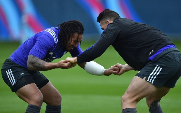 Ma'a Nonu and Sonny Bill Williams stretch during a training session at the Lensbury Hotel in Teddington.