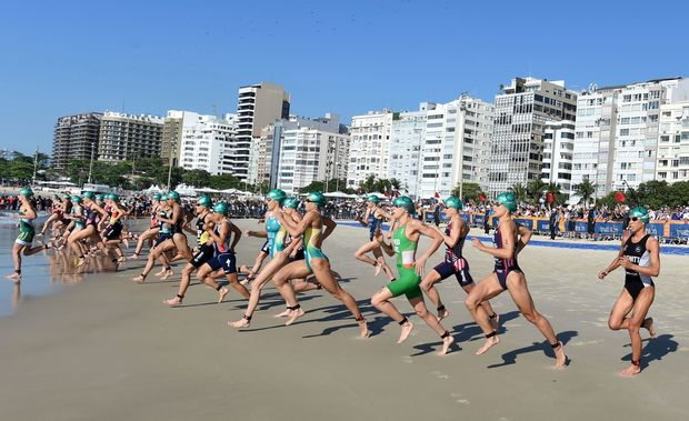 Triathletes competing at Copacabana Beach.