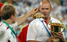 England's Jonny Wilkinson offers the lid of the Rugby World Cup to coach Clive Woodward after winning the 2003 tournament.