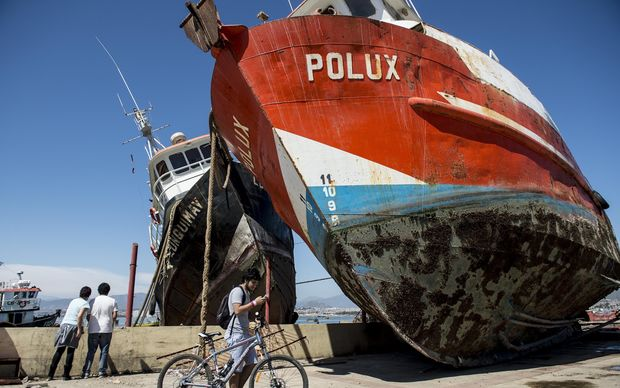 Fishing boats run aground in the Chilean port of Coquimbo.