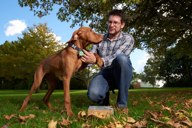 Photo of David Pattemore with Ollie, his bee-sniffing dog