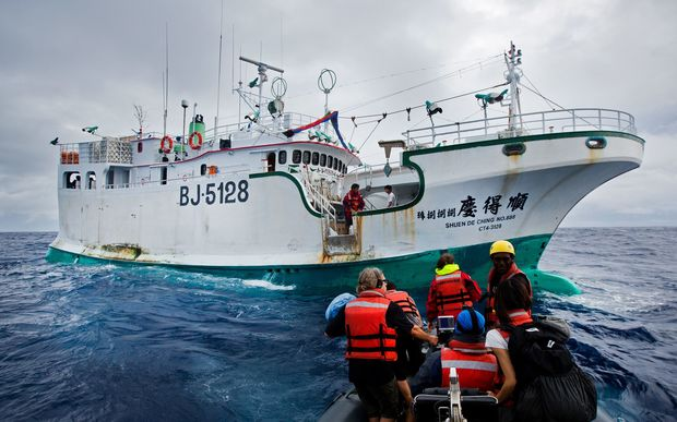 Greenpeace activists prepare to board illegal fishing vessel Shuen De Ching No 888. The Rainbow Warrior travels in the Pacific to expose out of control tuna fisheries. Tuna fishing has been linked to shark finning, overfishing and human rights abuses. 9 Sep, 2015