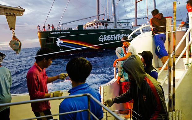 Crew of illegal fishing vessel Shuen De Ching No.888 look on as the Rainbow Warrior pulls up alongside. The Rainbow Warrior travels in the Pacific to expose out of control tuna fisheries. Tuna fishing has been linked to shark finning, overfishing and human rights abuses. 9 Sep, 2015