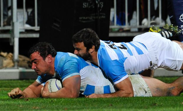 Agustin Creevy of Argentina scores a try against the All Blacks from a rolling maul with help from Martin Landajo, July, 2015.
