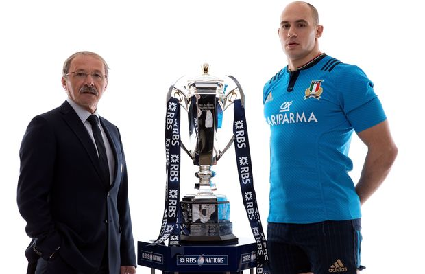 Italy coach Jacques Brunel and captain Sergio Parisse pose with the Six Nations trophy.