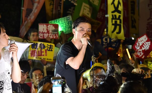 Students rally against Japanese PM's security bills which would allow troops to fight on foreign soil for the first time since World War II.