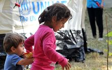 Migrant children walk at the Beli Manastir refugee transit center in North-Eastern Croatia, on September 19, 2015.