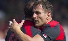 Mamuka Gorgodze of Georgia is congratulated after scoring a try against Tonga.
