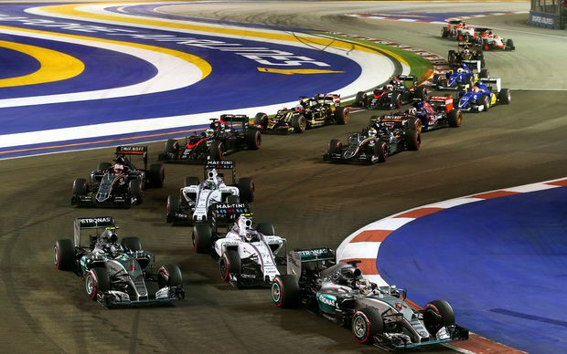 Racecars were forced to slow down when a man took to the track at this weekend's Singapore Grand Prix.