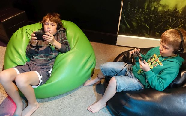 Riley Armstrong, 10, and his brother Floyd, 8, check out their compositions at the Musik: From Sound to Emotion exhibition in New Plymouth