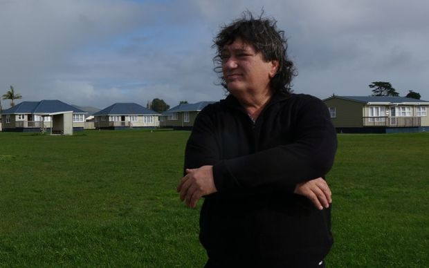 Ricky Houghton in front of the affordable housing project, Whare Ora.