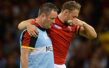 Cory Allen is helped from the field after being injured in his side's RWC over Uruguay.