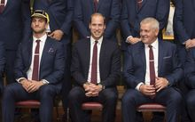 Prince William (middle), Wales Sam Warburton (left), and Wales' head coach Warren Gatland pose for a group photograph during the Wales' Welcome Ceremony for the Rugby World Cup.