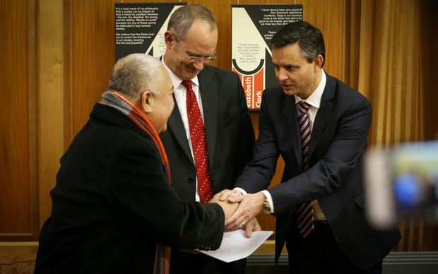 Reverend Iosefa Suamalie (left), Phil Twyford (middle) and James Shaw (right) shaking hands after the climate change petition was passed over today.