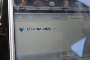 This is  an image of the  radio station read out on the Tesla dashboard , showing Radio New Zealand National.