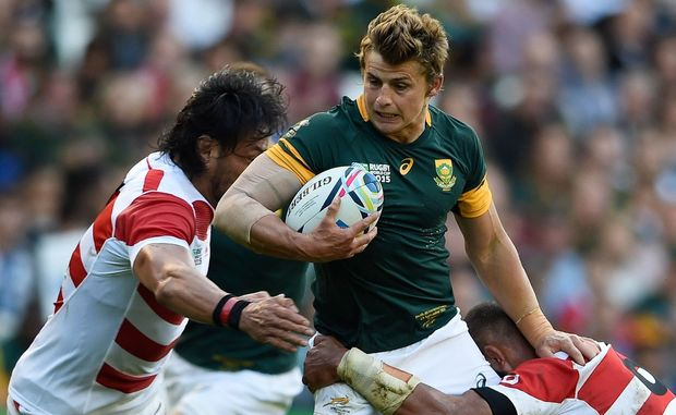 Patrick Lambie is tackled in South Africa's World Cup loss to Japan.