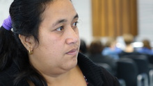 Ioane Teitiota's wife, Angua Erika, waits as her husband prepares to leave Auckland International Airport on Wednesday 23 September 2015. The family's application to be considered refugees from the effects of climate change in Kiribati has been declined, and Mr Teitiota is being deported today.