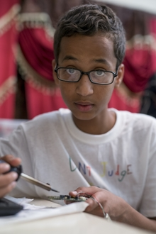 Ahmed Mohamed, a Texas Muslim teen arrested after taking his homemade clock to school, poses at his house in Irving, Texas on September 17, 2015.