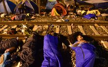 Syrian refugees sleep on the railway in Tovarnik, Croatia.