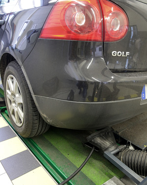 A Volkswagen 'Golf V' series deisel vehicle being given an emissions inspection, Hamburg, Germany, 23 September 2015.