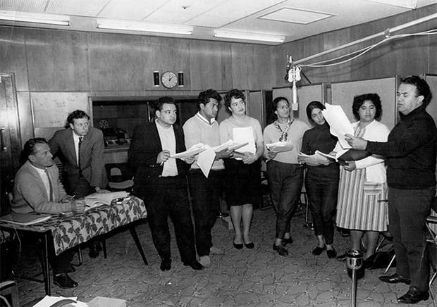 The cast record the play in the production studios at Broadcasting House, Wellington, in 1965. Those shown are, from left: William Austin, producer; Bruce Mason, playwright; and cast members Don Selwyn, Sam Stevens, Ngaire Karaka, Hannah Tatana, Diana Winterburn, Newha Taiaki and Īnia Te Wīata