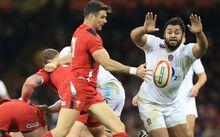 England's Billy Vunipola tries to charge down a kick from Wales scrum-half Mike Phillips, February, 2015.