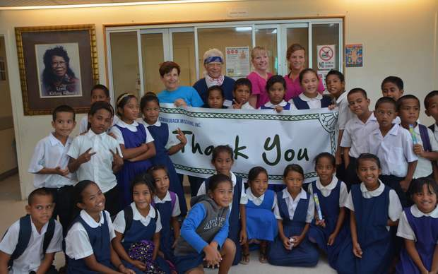 The Canvasback dental team with Ebeye students