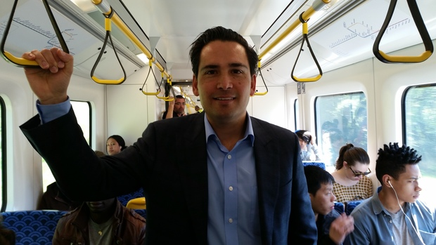 Transport Minister Simon Bridges on an Auckland train.