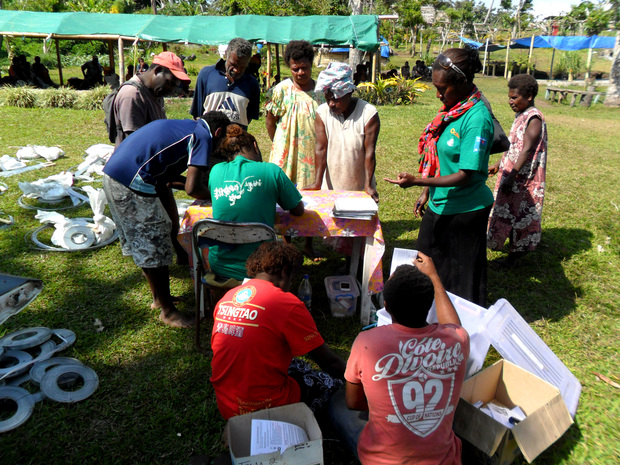 Rebuild kits being distributed on Tanna in Vanuatu by Care International.