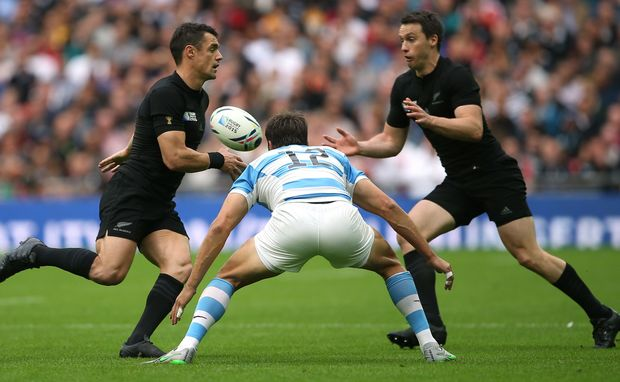 Dan Carter offloads the ball to Ben Smith in the All Blacks World Cup match with Argentina.