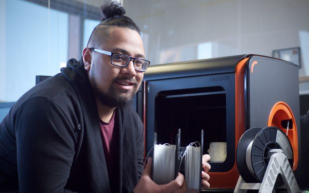 Victoria University student Lionel Taito-Matamua with a 3D printer.