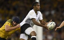 Fiji winger Aseli Tikoirotuma looks for support in their 2015 Rugby World Cup match against Australia.