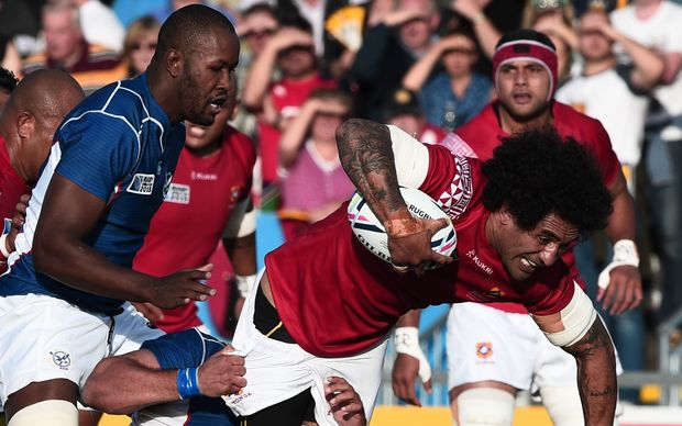 Hale T Pole is tackled during Tonga's Rugby World Cup win over Namibia, before limping off with a suspected ankle injury.