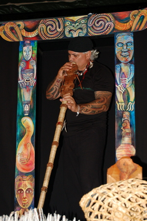 Artist James Webster with an example of what he calls karetao pūoro - singing Māori puppets.
