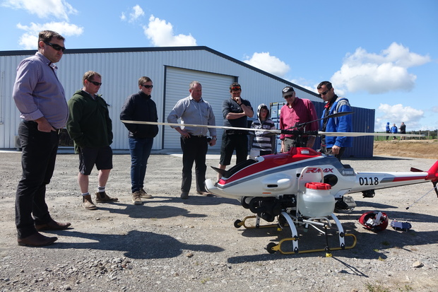 A group of curious farmers, spraying contractors and radio-controlled aircraft enthusiasts turned out in Lepperton to see the Yamaha RMAX put through its paces.