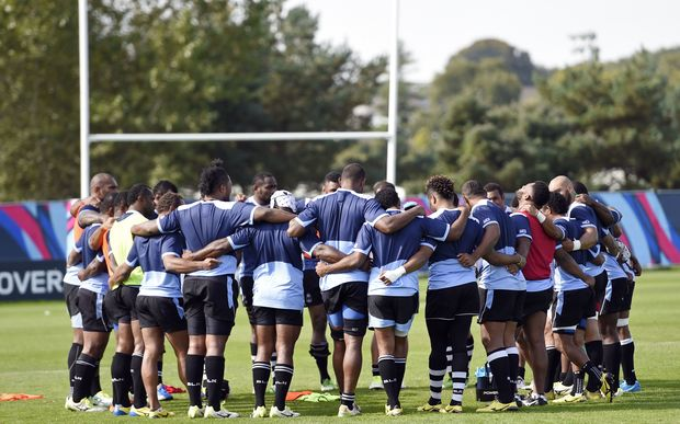 Fiji's players gather together during a Fiji team training session in Swansea.