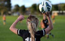 Laura Merrin, who now plays for Everton, prepares to take a throw-in for the Junior Ferns against the Young Matildas at Kristin School in Albany, Auckland, back in July 2013. Photo: Andrew Cornaga / Photosport.co.nz