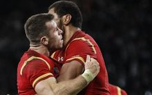 Try scorer Gareth Davies of Wales is congrautulated by Taulupe Faletau.