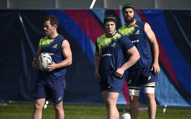 (L-R) Australia's Bernard Foley, David Pocock and Scott Fardy at a training session at Dulwich College in London, on October 1, 2015, during the 2015 Rugby World Cup. AFP PHOTO / MARTIN BUREAU