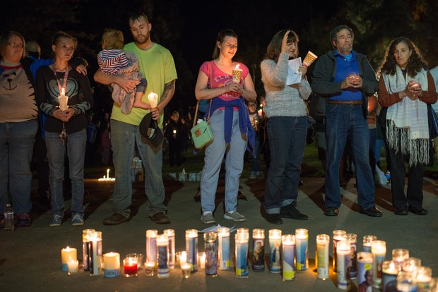 People pray during a candlelight vigil in Roseburg,Oregon for ten people killed and seven others wounded in a shooting at a community college.