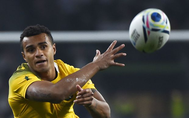 Australia's scrum half Will Genia passes the ball during a Pool A match of the 2015 Rugby World Cup between England and Australia at Twickenham stadium, south west London, on October 3, 2015