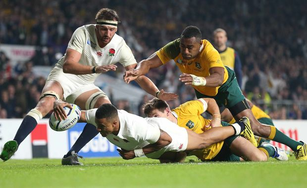 England winger Anthony Watson scores against Australia at Twickenham.