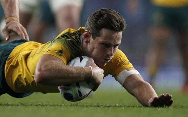 Australia first-five Bernard Foley scores his team's second try during a Pool A match of the 2015 Rugby World Cup between England and Australia at Twickenham stadium, south west London, on October 3, 2015