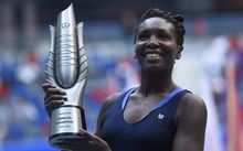 Venus Williams of the US poses with her trophy after beating Garbine Muguruza of Spain during the women's singles final at the Wuhan Open tennis tournament in Wuhan, central China's Hubei province on October 3, 2015. AFP PHOTO / FRED DUFOUR